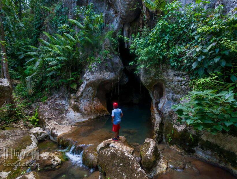 boy at atm cave entrance