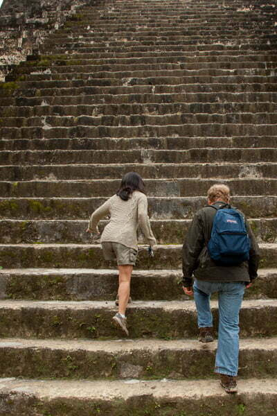 couple walk the mayan ruins steps